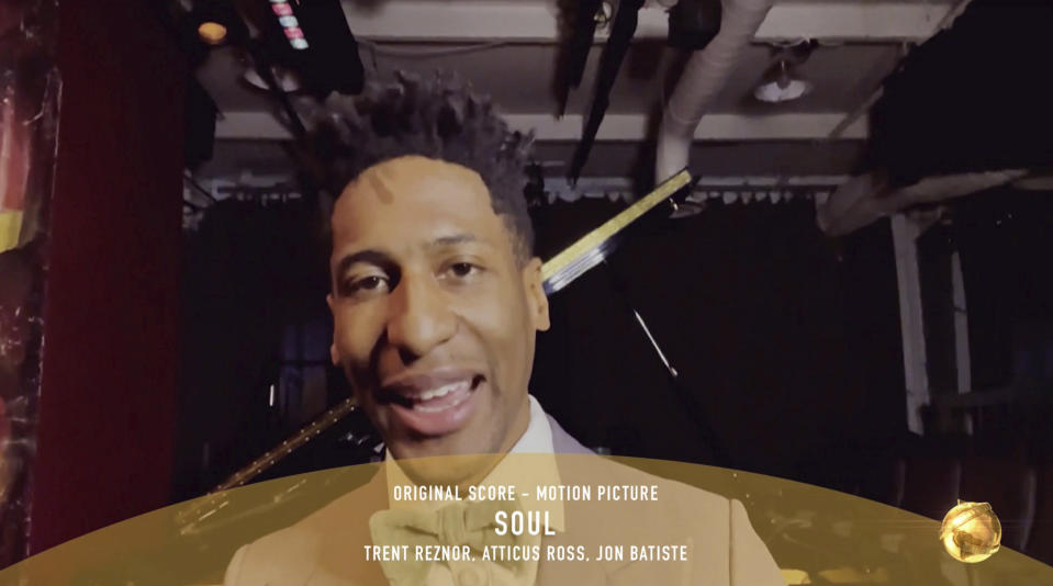 "In this video grab issued Sunday, Feb. 28, 2021, by NBC, Jon Batiste accepts the award for best original score in a motion picture for ""Soul"" at the Golden Globe Awards. (NBC via AP)"