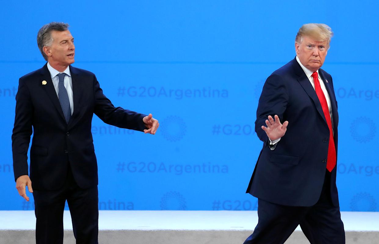 President Donald Trump is welcomed by Argentina's President Mauricio Macri as he arrives for the G20 leaders summit in Buenos Aires, Argentina November 30, 2018. (Photo: Marcos Brindicci/Reuters)