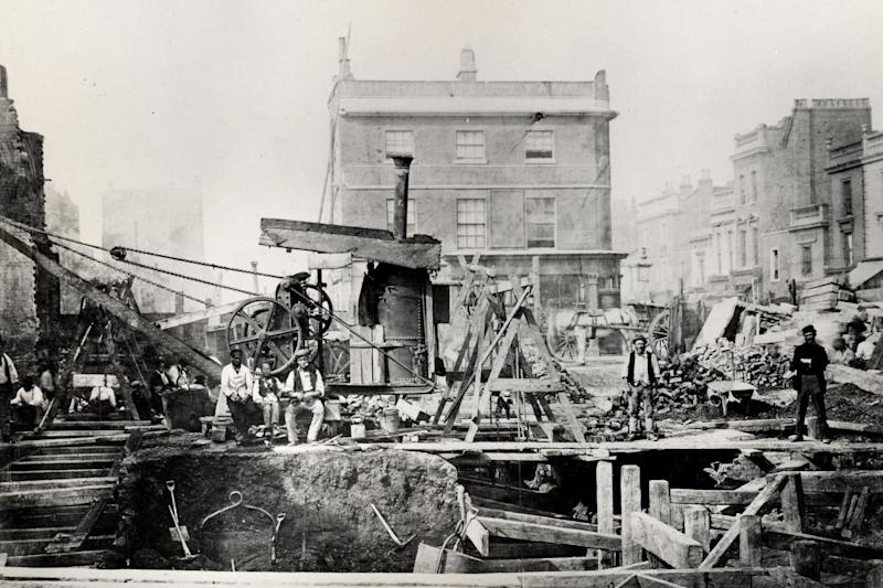 The 'cut and cover' method being used to build underground tunnels at Praed Street, Paddington, circa 1866. (London Transport Museum)
