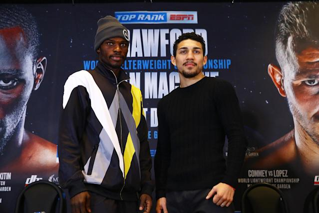 IBF lightweight champion Richard Commey (L) defends his title Saturday vs. undefeated Teofimo Lopez in the co-main event of Saturday's Top Rank show on ESPN. (Mikey Williams/Top Rank)