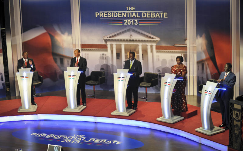In this photo taken Monday, Feb. 11, 2013, Kenyan presidential candidates, from left, Uhuru Kenyatta, Peter Kenneth, Musalia Mudavadi, Martha Karua, and Raila Odinga, take part with other candidates, unseen, in a televised debate in Nairobi, Kenya. Three weeks before they go to the polls, millions of Kenyans watched and listened to the nation's first-ever presidential debate, with the two front-running candidates trading barbs over the looming trial of one of them in the International Criminal Court. (AP Photo)
