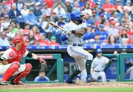 May 27, 2018; Philadelphia, PA, USA; Toronto Blue Jays right fielder Dwight Smith Jr. (27) hits an 2-RBI double during the sixth inning against the Philadelphia Phillies at Citizens Bank Park. Mandatory Credit: Eric Hartline-USA TODAY Sports