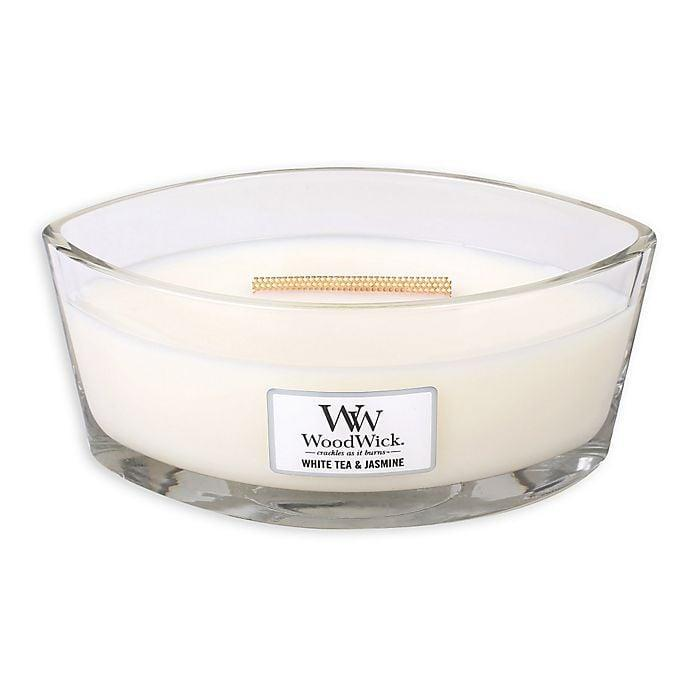 <p>The <span>WoodWick® White Tea & Jasmine Candle</span> ($30) comes in three different sizes, 10oz round jar, 16oz large oval-shaped jar, and 22oz round tall jar. The glass jars and wooden lids are incredibly sturdy and of good quality. In fact, you can be sustainable and reuse the candles, once burned through, as chic storage containers to make your home even calmer. </p>