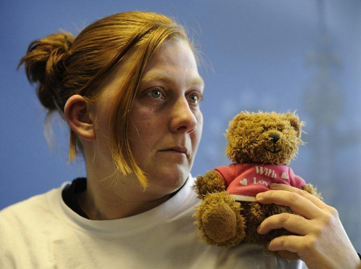 Matthews holds her daughter's favourite teddy bear during an appeal in 2008.