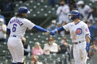 Chicago Cubs' Jake Marisnick (6) celebrates with teammate Nico Hoerner right, at home plate after hitting a solo home run during the fourth inning of a baseball game against the Milwaukee Brewers, Friday, April 23, 2021, in Chicago. (AP Photo/Paul Beaty)