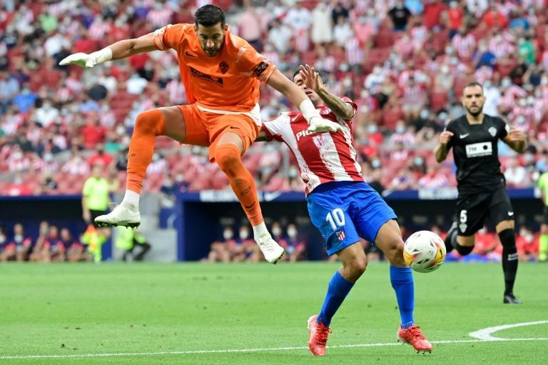Artful dodger: Angel Correa dodged a challenge from goalie Kiko Casillas and ran on to score