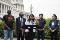 From left, Rep. Mondaire Jones, D-N.Y., Rep. Al Green, D-Texas, Rep. Cori Bush, D-Mo., Rep. Jimmy Gomez, D-Calif., and Rep. Alexandria Ocasio-Cortez, D-N.Y., after it was announced that the Biden administration will enact a targeted nationwide eviction moratorium outside of Capitol Hill in Washington on Tuesday, August 3, 2021. For the past five days, lawmakers and activists primarily led by Rep. Cori Bush, D-Mo., have been sitting in on the steps of Capitol Hill to protest the expiration of the eviction moratorium. (AP Photo/Amanda Andrade-Rhoades)