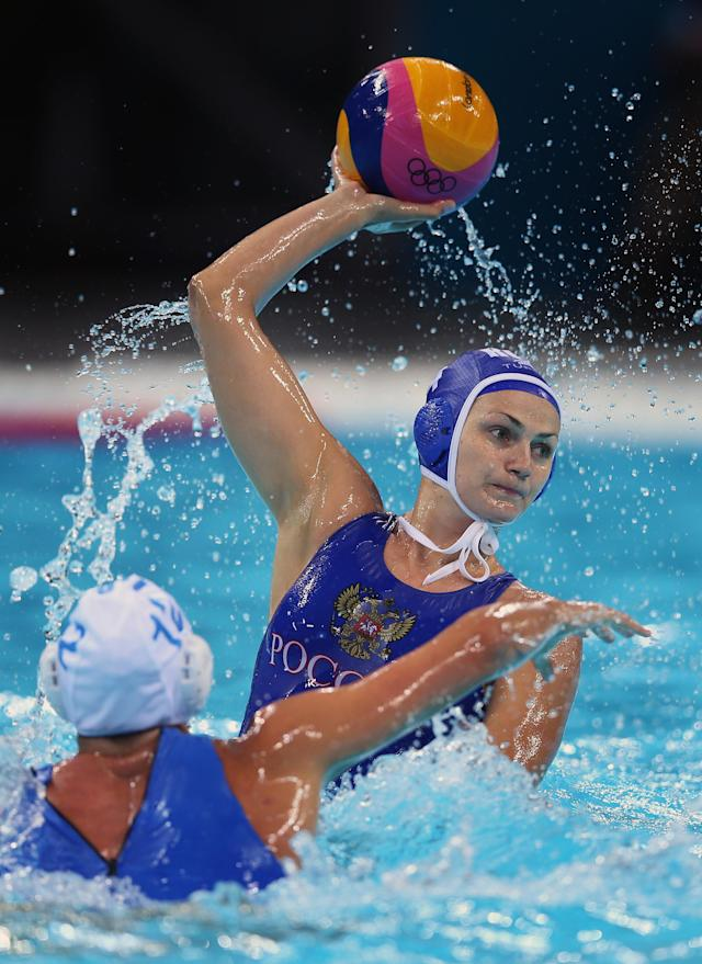 LONDON, ENGLAND - AUGUST 01: Sofya Konukh of Russia is blocked by Diana Antonova of Italy on Day 5 of the London 2012 Olympics at Water Polo Arena on August 1, 2012 in London, England. (Photo by Jeff J Mitchell/Getty Images)