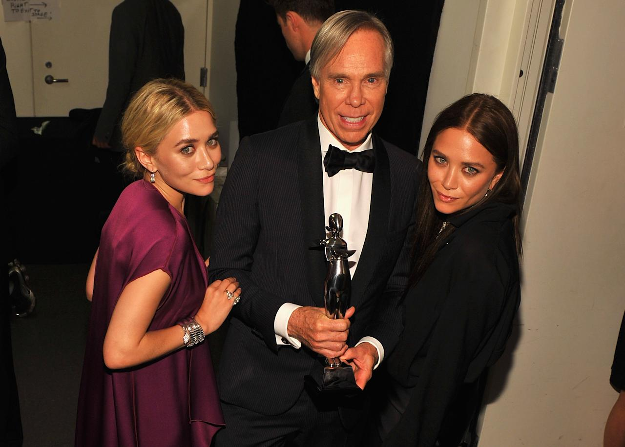 NEW YORK, NY - JUNE 04:  Designers Ashley Olsen and Mary Kate Olsen and Tommy Hilfiger pose with award at the 2012 CFDA Fashion Awards at Alice Tully Hall on June 4, 2012 in New York City.  (Photo by Larry Busacca/Getty Images)