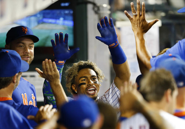 New York Mets' Francisco Lindor celebrates after hitting a home run against the New York Yankees during the eighth inning of a baseball game on Sunday, Sept. 12, 2021, in New York. (AP Photo/Noah K. Murray)