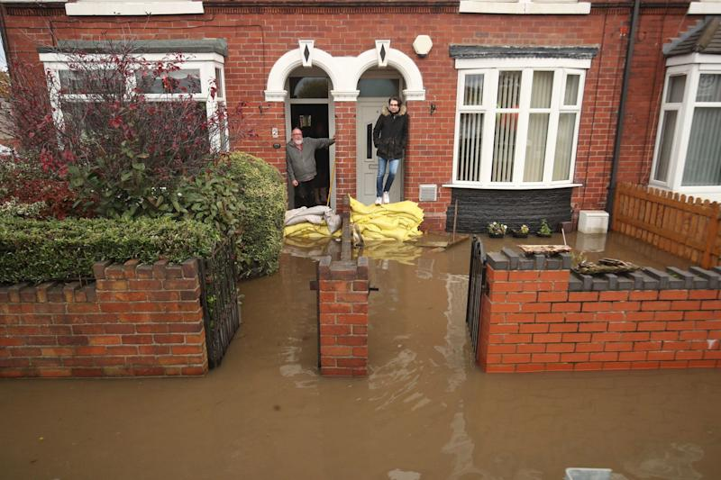 Sandbags hold the fort between residents and rising flood water (PA)