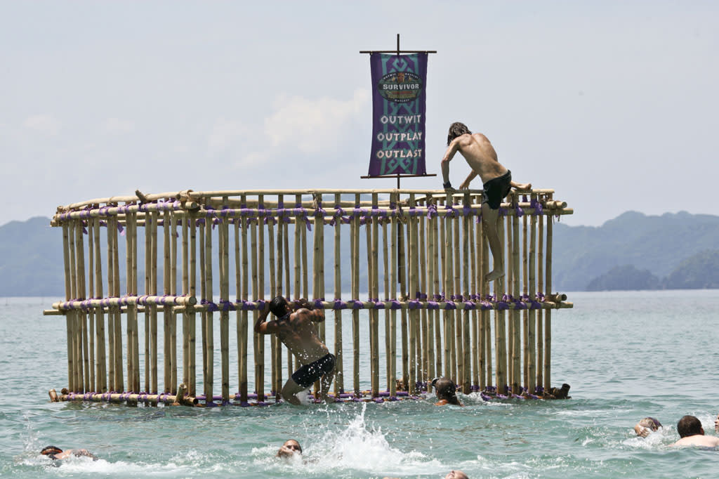 """There's Gonna be Hell to Pay"" - Brandon Hantz and Erik Reichenbach of the Bikal Tribe climb up an obstacle during the Immunity Challenge on the third episode of ""Survivor: Caramoan - Fans vs. Favorites."""