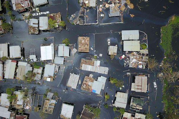 PHOTO: In this Sept. 22, 2017, file photo, an aerial view shows the flooded neighborhood of Juana Matos in the aftermath of Hurricane Maria in Catano, Puerto Rico. (Ricardo Arduengo/AFP via Getty Images, FILE)