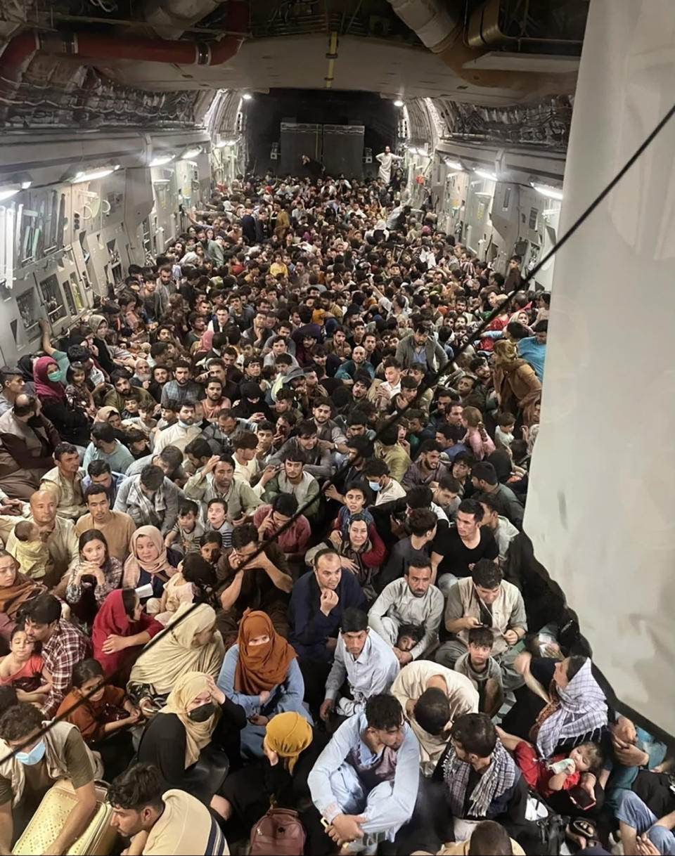Afghan citizens pack inside a U.S. Air Force C-17 Globemaster III, as they are transported from Hamid Karzai International Airport in Afghanistan, Sunday, Aug. 15, 2021. On Friday, Aug. 20, 2021, The Associated Press reported on stories circulating online incorrectly claiming another photo showed a plane full of Afghan refugees being evacuated from the country this week, with not a single woman or child among them. In fact, that photo, which appeared online as early as 2018, shows Afghan refugees being sent back to their country from Turkey, according to a story at the time from Turkey's state-run news agency, the Anadolu Agency. Photos captured this week show that hundreds of Afghan men, women and children have been evacuated from Afghanistan since the Taliban takeover. (Capt. Chris Herbert/U.S. Air Force via AP)