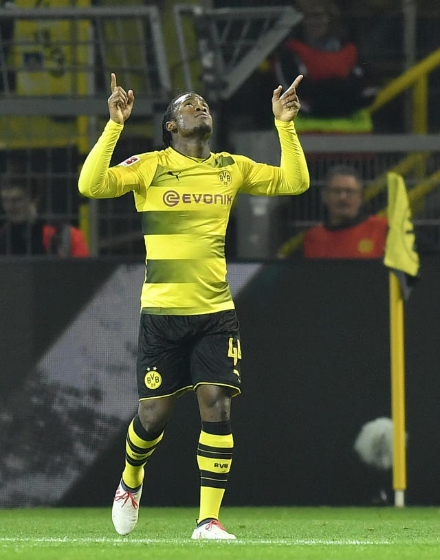 Dortmund's Michy Batshuayi celebrates after scoring during the German Bundesliga soccer match between Borussia Dortmund and Eintracht Frankfurt in Dortmund, Germany, Sunday, March 11, 2018. (AP Photo/Martin Meissner)