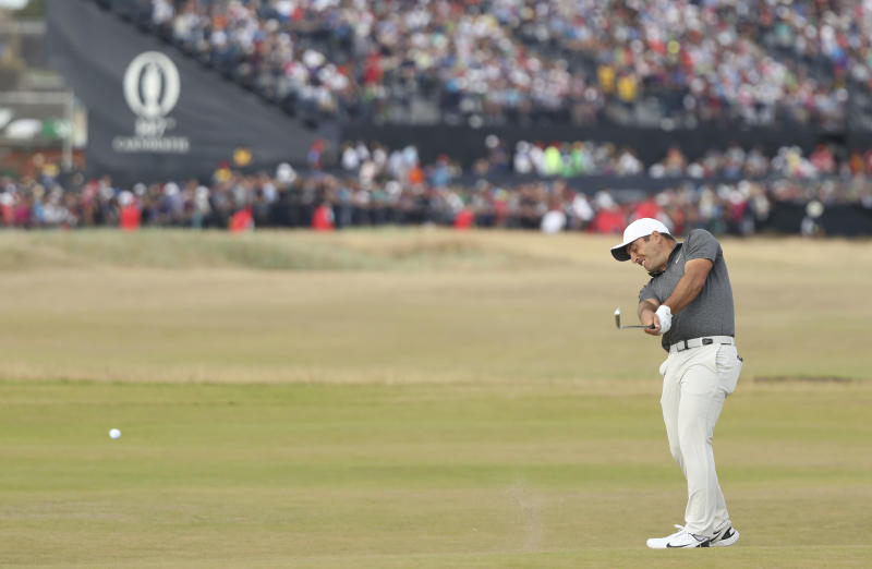 The Latest: Molinari breaks US stranglehold on majors