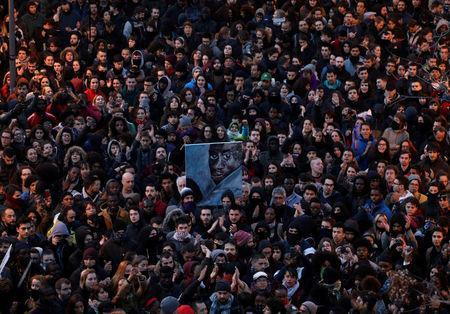 People attend a gathering to protest against the death of a street hawker in central Madrid, Spain March 16, 2018. REUTERS/Sergio Perez TPX IMAGES OF THE DAY