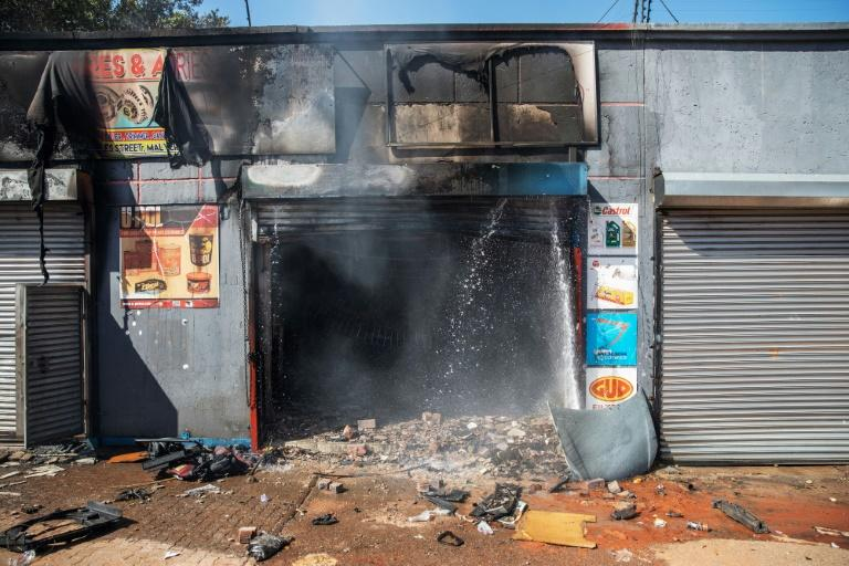 Attacked: The remains of a store in Johannesburg's Malvern area after a night of violence