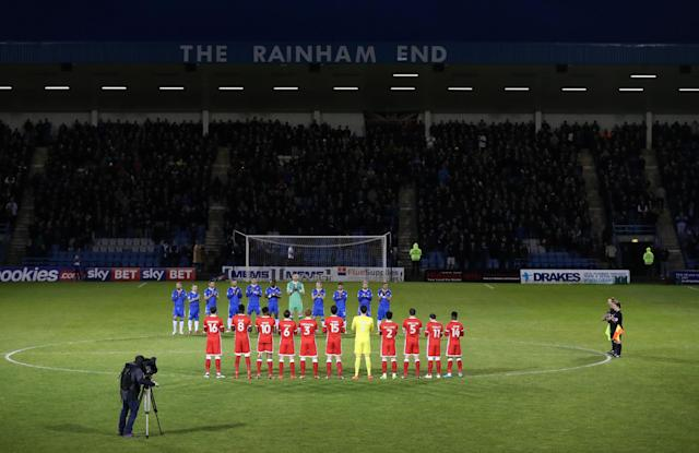 "Soccer Football - League One - Gillingham vs Milton Keynes Dons - MEMS Priestfield Stadium, Gillingham, Britain - March 29, 2018 A minutes applause is held before kick off for bbc sports reporter Neil Bell Action Images/Peter Cziborra EDITORIAL USE ONLY. No use with unauthorized audio, video, data, fixture lists, club/league logos or ""live"" services. Online in-match use limited to 75 images, no video emulation. No use in betting, games or single club/league/player publications. Please contact your account representative for further details."
