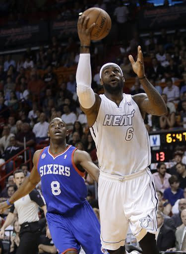 Miami Heat's LeBron James (6) shoots as Philadelphia 76ers' Damien Wilkins (8) watches during the first half of an NBA basketball game, Saturday, April 6, 2013, in Miami. (AP Photo/Lynne Sladky)
