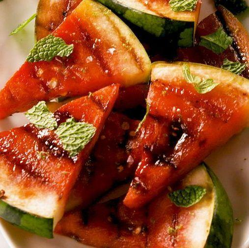 """<p>Grilling watermelon not only changes the texture of the fruit, it lends a smoky flavour and brings out its natural sweetness. </p><p>Get the <a href=""""https://www.delish.com/uk/cooking/recipes/a35721374/grilled-watermelon-recipe/"""" rel=""""nofollow noopener"""" target=""""_blank"""" data-ylk=""""slk:Grilled Watermelon"""" class=""""link rapid-noclick-resp"""">Grilled Watermelon</a> recipe.</p>"""
