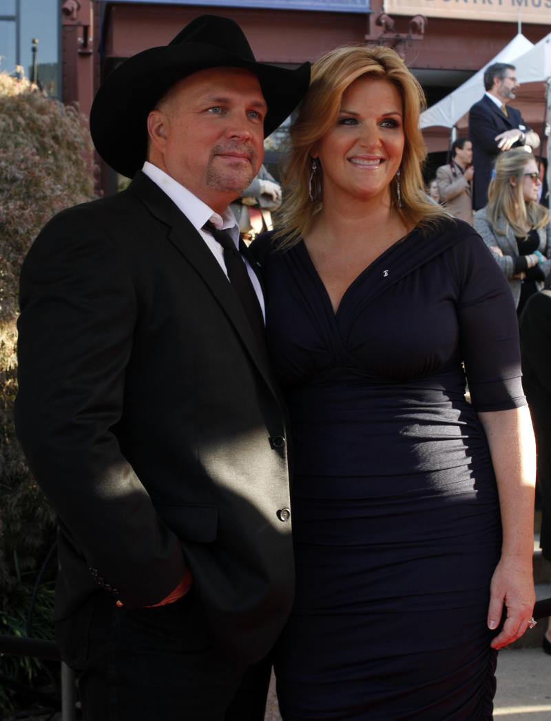 Garth Brooks and Trisha Yearwood attends the Country Music Hall of Fame Inductions on Sunday, Oct. 21, 2012 in Nashville, Tenn. (Photo by Wade Payne/Invision/AP)