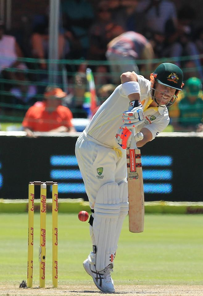 Australia's batsman David Warner plays a shot on the fourth day of their 2nd cricket test match against South Africa at St George's Park in Port Elizabeth, South Africa, Sunday, Feb. 23, 2014. (AP Photo/ Themba Hadebe)