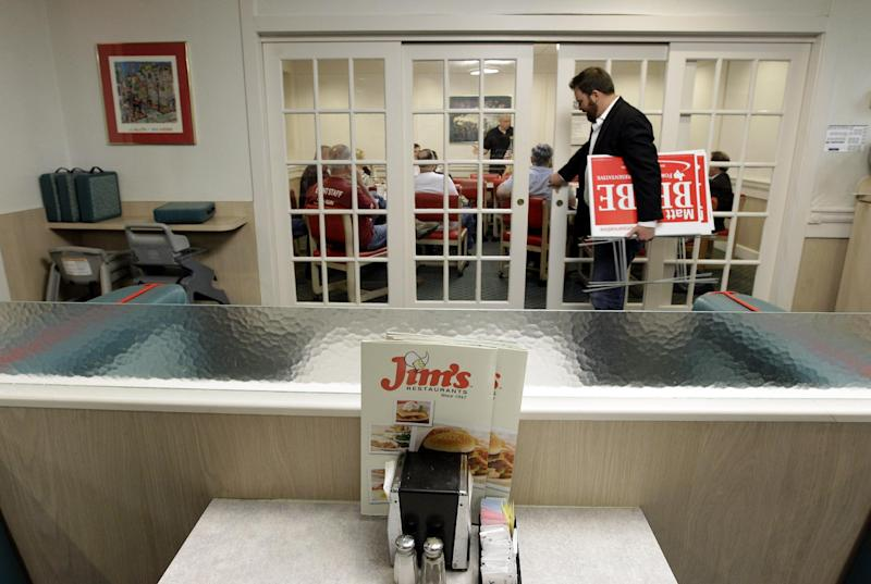 In this Tuesday, March 20, 2012 photo, a campaign worker delivers election signs to a tea party meeting in a restaurant in San Antonio. Following the tide-turning elections of 2010, when the tea party revolution sent new conservatives to governors' mansions, statehouses and, of course, Congress, what's the group's role now? The tea party has changed, but it's very much alive. (AP Photo/Eric Gay)