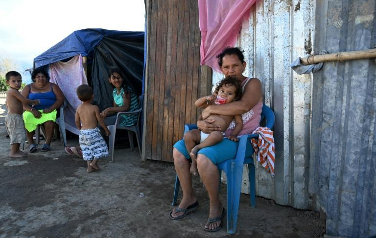 Many people in the impoverished Bon Samaritain neighborhood of La Lima dream of emigrating to the US