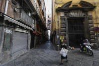 NAPLES, CAMPANIA, ITALY - 2020/05/03: A woman wearing a protective mask walks in the center of the city of Naples, after a government decree declaring all of Italy a protected area to combat covid-19 coronavirus infection. (Photo by Salvatore Laporta/KONTROLAB/LightRocket via Getty Images)