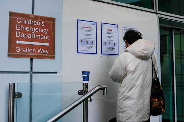 A sign directs patients towards an NHS 111 coronavirus pod at London University Hospital. (Getty Images)