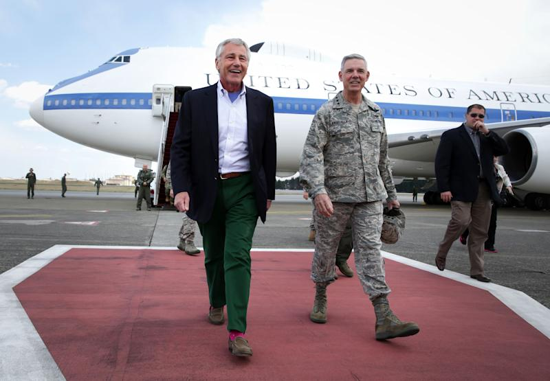 "U.S. Secretary of Defense Chuck Hagel, walks with Commander of U.S. Force Japan Lt. Gen. Salvatore ""Sam"" Angelella upon his arrival on Saturday, April 5, 2014 at Yokota Air Force Base in Fussa, Japan. Hagel is on an Asian trip, the fourth since he took office, to Japan, China and Mongolia. (AP Photo/Alex Wong, Pool)"