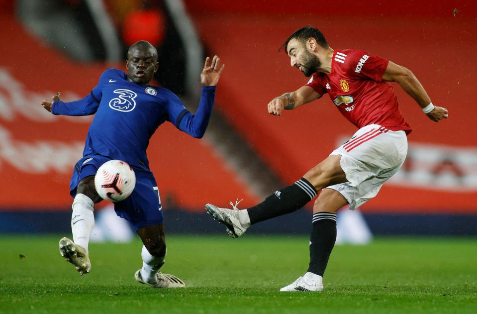 Manchester United's Bruno Fernandes (right) in action with Chelsea's N'Golo Kante.