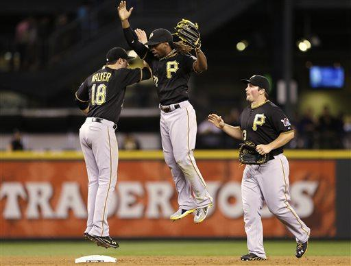 Pittsburgh Pirates' Neil Walker (18), Andrew McCutchen, center, and Travis Snider celebrate after the team beat the Seattle Mariners in a baseball game Tuesday, June 25, 2013, in Seattle. The Pirates won 9-4. (AP Photo/Elaine Thompson)