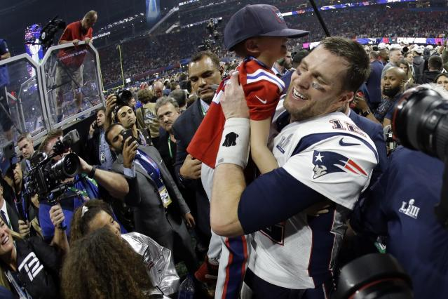 <p>New England Patriots' Tom Brady lifts his son, Ben, after the NFL Super Bowl 53 football game against the Los Angeles Rams, Sunday, Feb. 3, 2019, in Atlanta. The Patriots won 13-3. (AP Photo/Mark Humphrey) </p>