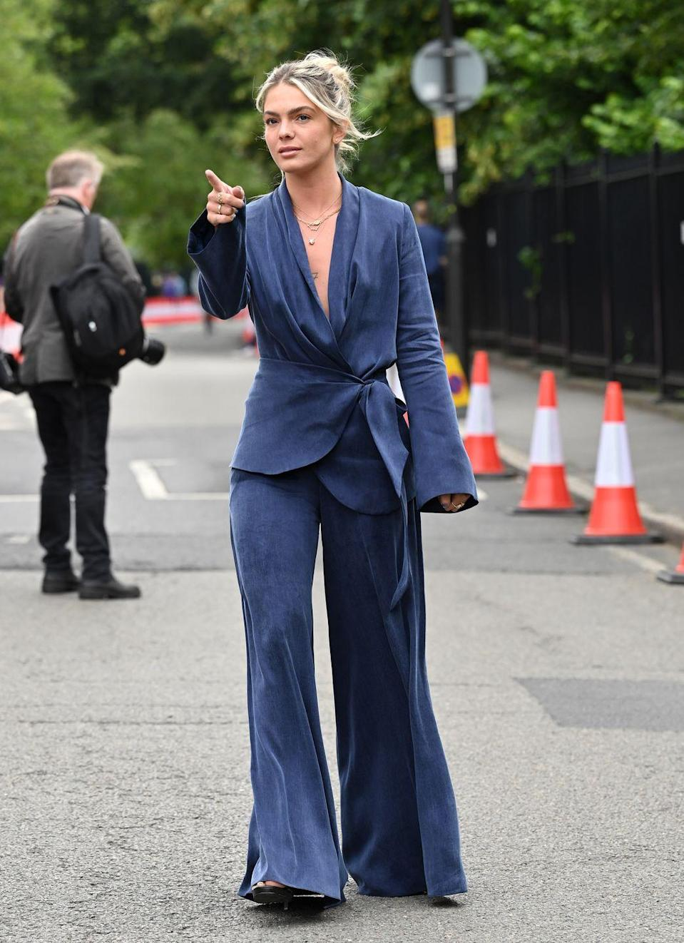 <p>The singer cut an elegant figure in a silky two-piece.</p>