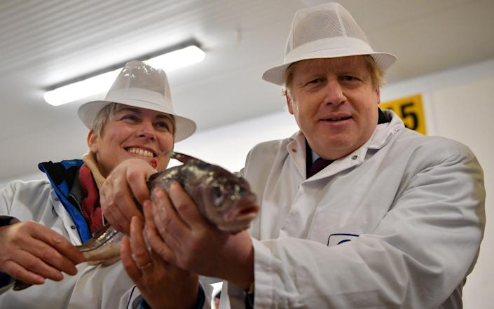 Britain's Prime Minister Boris Johnson visits Grimsby Fish Market in Grimsby -  REUTERS
