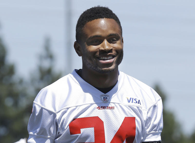FILE - In this May 22, 2013, file photo, San Francisco 49ers cornerback Nnamdi Asomugha smiles for photographers as he leaves the practice field at an NFL football training camp in Santa Clara, Calif. Asomugha married actress Kerry Washington on June 24 in Hailey, Idaho. E! was the first to report the nuptials Wednesday, July 3, and posted a copy of the couple's marriage license online. (AP Photo/Jeff Chiu, File)