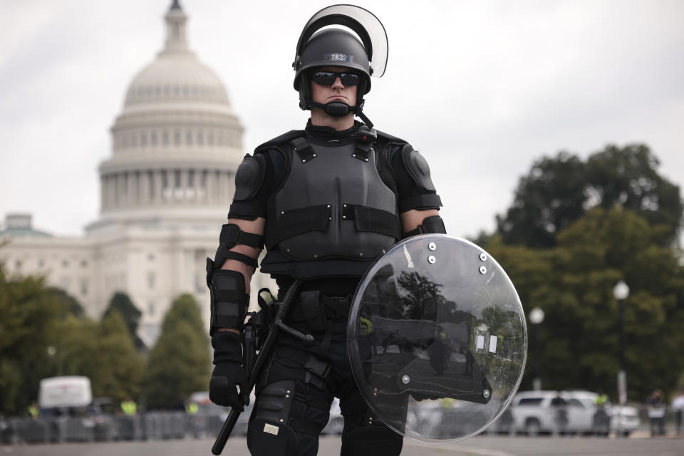 A police officer in riot gear monitors the scene which failed to really materialise. Source: Getty
