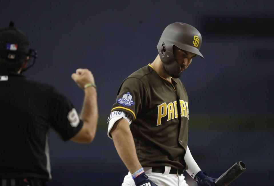 The San Diego Padres' Eric Hosmer, right, reacts as umpire James Hoye calls a strike during the first inning of the team's baseball game against the Arizona Diamondbacks on Friday, Aug. 17, 2018, in San Diego. (AP Photo/Gregory Bull)