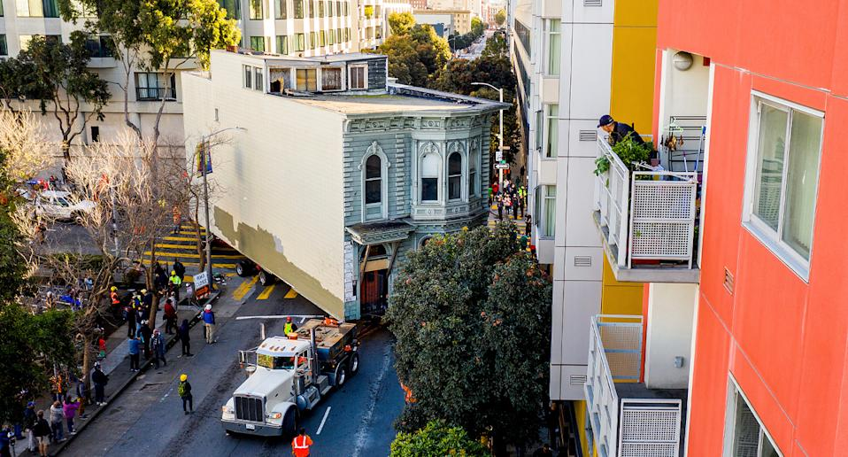 A two-storey Victorian home being moved through the streets of San Francisco.
