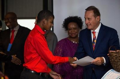 A Park West Foundation student receives a special award at the nonprofit group's annual recognition ceremony for Michigan youth in the foster care system who are graduating from high school.
