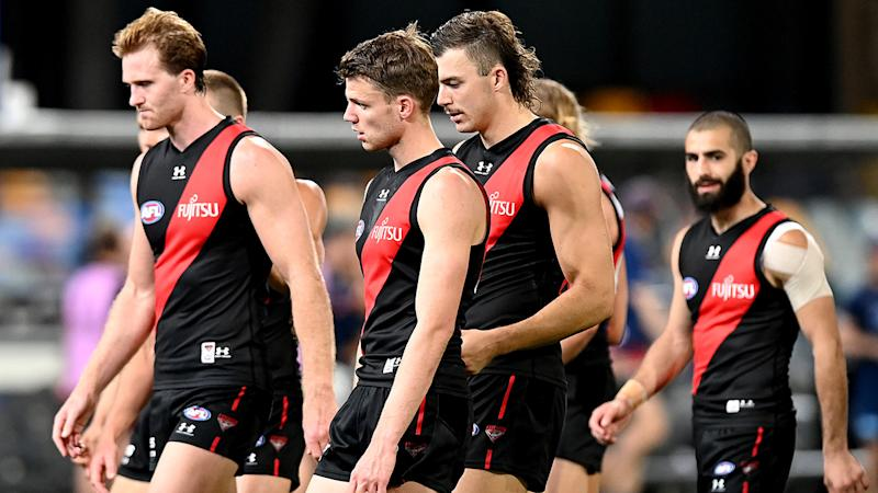 Essendon players look dejected after losing their round 16 AFL match to Geelong. (Photo by Bradley Kanaris/Getty Images)