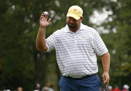 International team member Brendon de Jonge of Zimbabwe reacts after making his putt on the sixth hole at the 2013 Presidents Cup golf tournament at Muirfield Village Golf Club in Dublin, Ohio