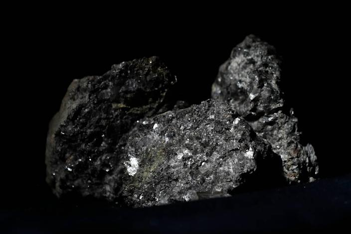 Pieces of lithium sparkle in this ore sample placed on a table in Prague, Czech Republic, in 2017. A company has proposed a mine for the key battery component near Cherryville, NC, just outside of Charlotte. But the proposal has met some opposition.