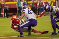 Kansas City Chiefs wide receiver Marcus Kemp (85) scores past Minnesota Vikings safety Camryn Bynum (43) and safety Myles Dorn (46) during the first half of an NFL football game Friday, Aug. 27, 2021, in Kansas City, Mo. (AP Photo/Charlie Riedel)