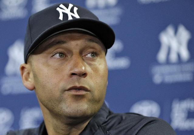 New York Yankees shortstop Derek Jeter listens to a question during a news conference Wednesday, Feb. 19, 2014, in Tampa, Fla. Jeter has announced he will retire at the end of the 2014 season. (AP Photo/Chris O'Meara)