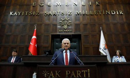 Turkey's Prime Minister Binali Yildirim addresses members of parliament from his ruling AK Party during a meeting in Ankara