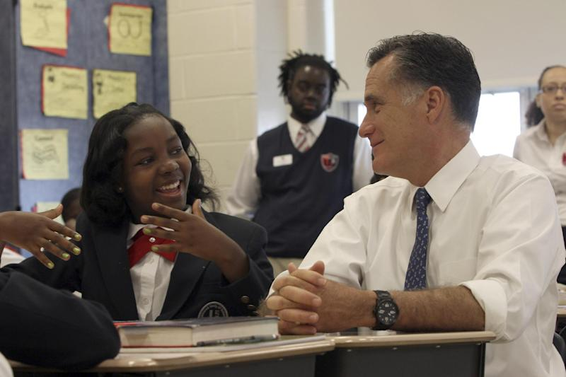Republican presidential candidate, former Massachusetts Gov. Mitt Romney talks with Salina Beattie during a tour of the 6th grade language arts class at the Universal Bluford Charter School, Thursday, May 24, 2012, in Philadelphia. (AP Photo/Mary Altaffer)