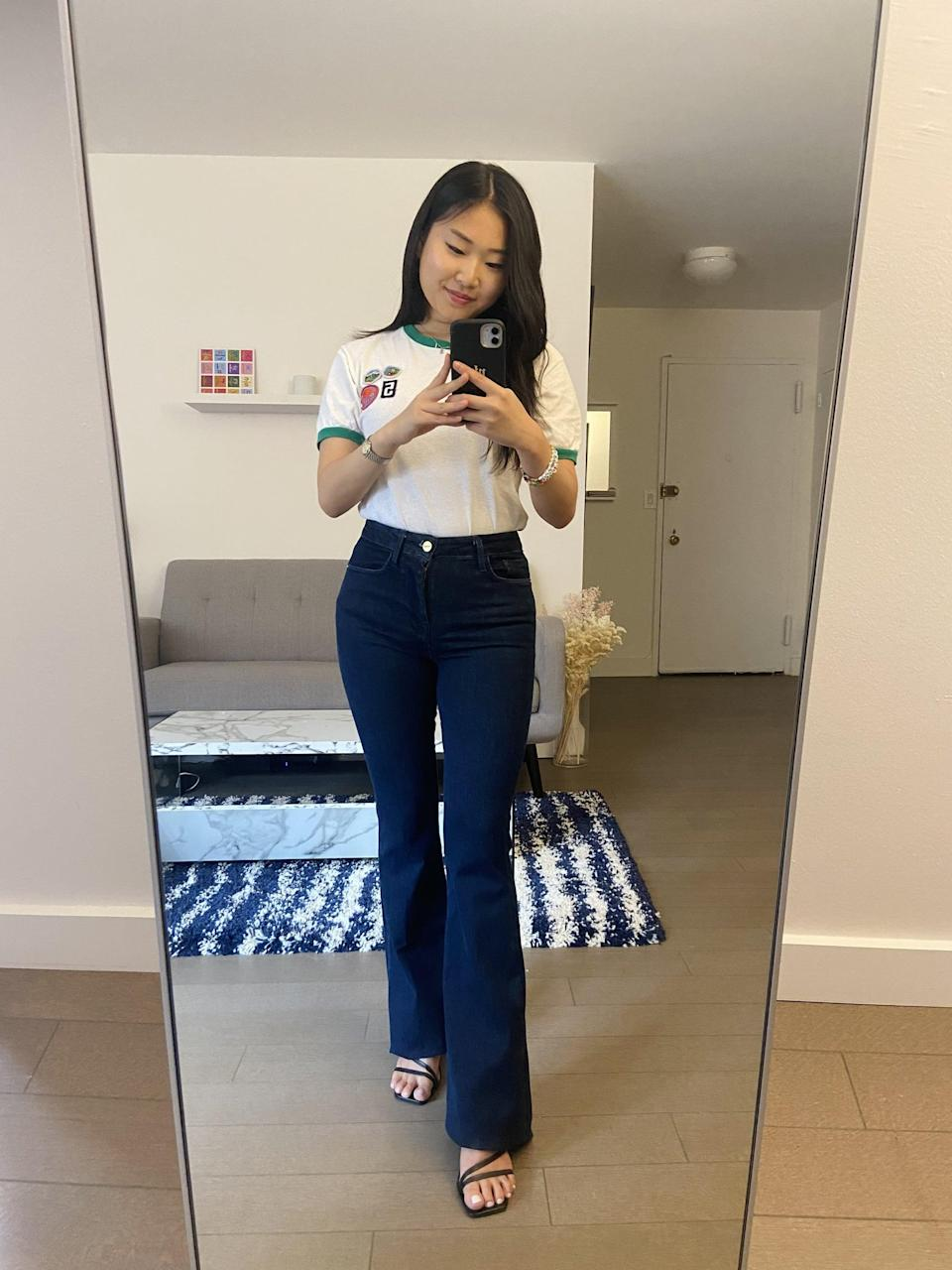 """<div class=""""pullquote-container""""><blockquote class=""""pullquote"""">""""They almost feel like jeggings (if you remember what those were like)!""""</blockquote></div> <p>""""It's hard to believe these jeans fit <em>five</em> other waist sizes, because they feel like they were made for me and my usual size 25 waist - minus the length, but we'll get into that later. As the description promises, the Le One Flare is super-stretchy and buttery soft, which means they slide right on and are the ideal jean for easing back into high-waisted denim. They almost feel like jeggings (if you remember what those were like)! But instead of cutting you off, the flare truly gives the illusion of longer legs. Really, my only issue with these jeans was the length. I'm 5'2"""" and the jeans were about a foot too long (I rolled them up here), but as soon as I get in with my tailor, I imagine I'll be wearing 'em pretty regularly."""" - Yerin Kim, associate editor, trending and viral features</p>"""